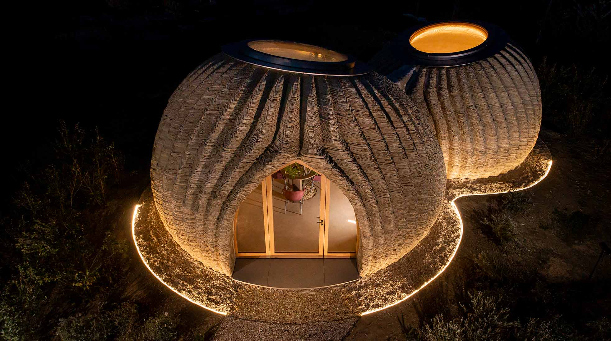 3D printed house of clay at night