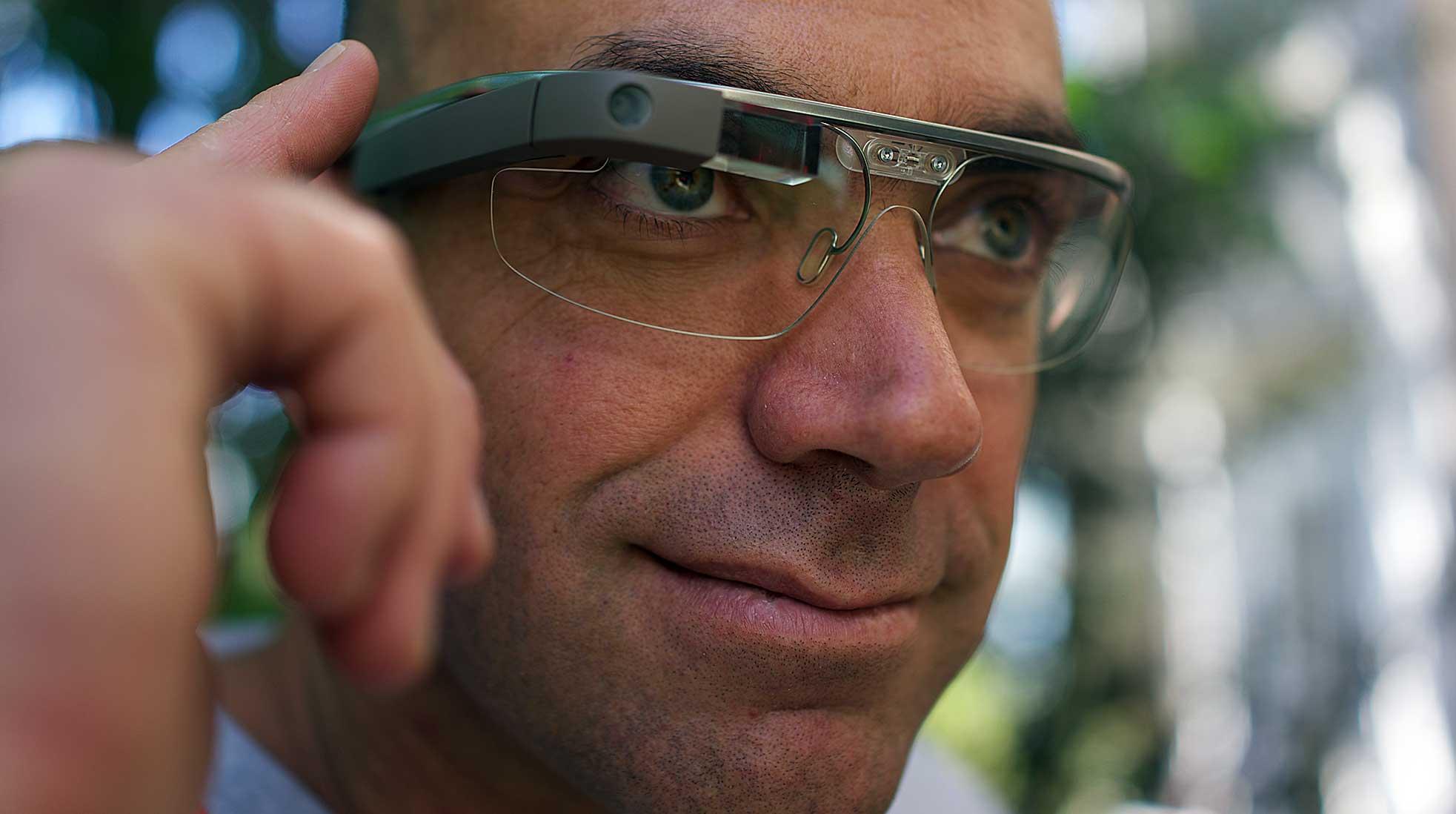 A male person wearing Google's smart glasses Google Glass